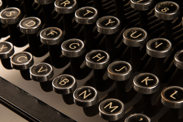 old manual typewriter keyboard representing storytelling tools